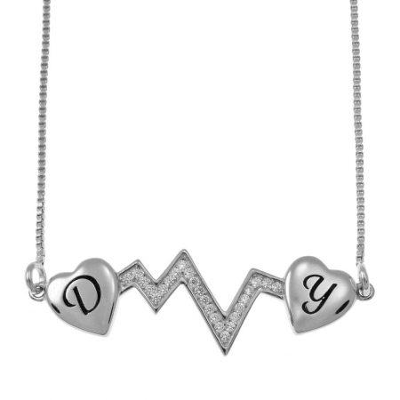 Collar latido de corazón con dos iniciales